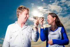 Happy couple with glasses of wine Stock Images