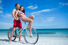 Happy couple going on a bike ride Royalty Free Stock Image
