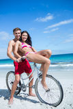 Happy couple going on a bike ride Stock Photos