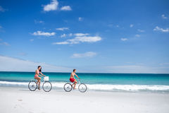 Happy couple going on a bike ride Stock Photo