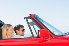 Happy couple going on holidays together Stock Photography