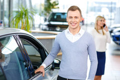 Happy couple going to buy a car Stock Photography