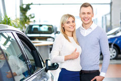 Happy couple going to buy a car Stock Image
