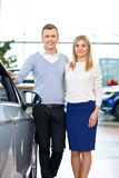 Happy couple going to buy a car royalty free stock image