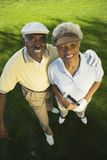Happy Couple On Golf Course Royalty Free Stock Images