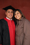 Happy couple on graduation day. Graduation day for attractive young man and his beautiful girlfriend Stock Images