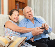 Happy couple grandparents in the house Royalty Free Stock Image