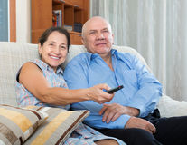 Happy couple grandparents in the house Royalty Free Stock Photos
