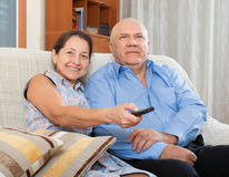 Happy couple grandparents in the house Stock Image