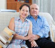 Happy couple grandparents in the house Stock Images