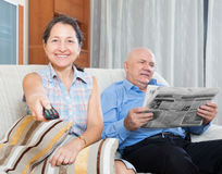 Happy couple of grandparents with newspaper Royalty Free Stock Images
