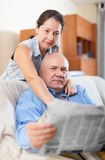 Happy couple of grandparents with newspaper Stock Photography