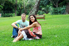 happy couple on grass Royalty Free Stock Image