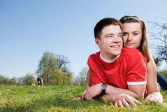 A happy couple on a green meadow Royalty Free Stock Photography