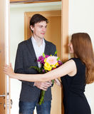 Happy couple greeting in the doorway Stock Photos
