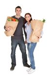 Happy couple with grocery shopping bags Stock Photos