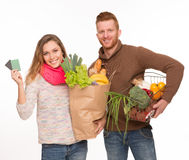 Happy couple with grocery shopping bags Royalty Free Stock Image