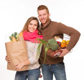 Happy couple with grocery shopping bags Royalty Free Stock Photo