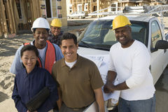 Happy Couple With Group Of Architects At Site Stock Photo