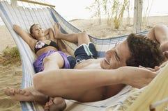 Happy Couple in Hammock on Beach Royalty Free Stock Photo