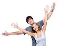Happy couple with the hands lifted upwards Stock Photography