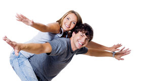 Happy couple with the hands lifted upwards Royalty Free Stock Photography