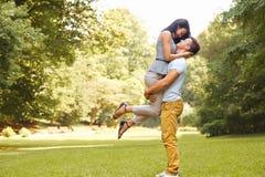 Happy couple has a fun in summer park Royalty Free Stock Photos