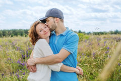 The happy couple has a rest in the field Stock Photos