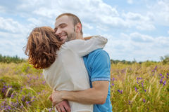 The happy couple has a rest in the field Royalty Free Stock Photo