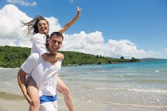 Happy couple have fun on the beach Royalty Free Stock Photos