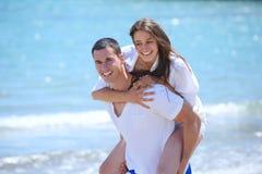 Happy couple have fun on the beach Stock Photos