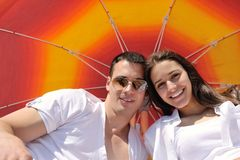 Happy couple have fun on the beach Stock Image