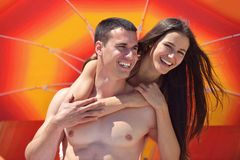 Happy couple have fun on the beach Royalty Free Stock Images
