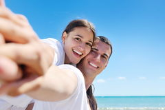 Happy couple have fun on the beach Stock Photography