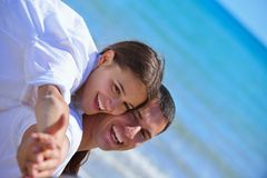 Happy couple have fun on the beach Stock Photo