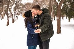 Happy couple have fun with Bengal lights. royalty free stock photo