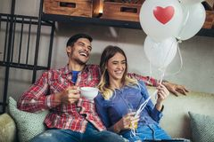 Couple have fun in cafe celebrating Valentine`s Day royalty free stock photos