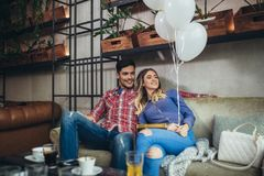 Couple have fun in cafe celebrating Valentine`s Day royalty free stock image