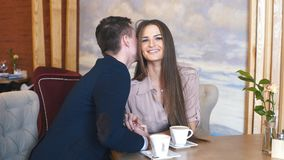 Happy couple have fun in cafe stock video footage