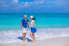 Happy couple have fun on Caribbean beach vacation Stock Photos