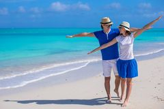 Happy couple have fun on Caribbean beach vacation Stock Image