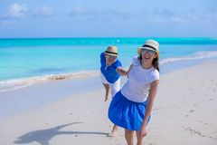 Happy couple have fun on Caribbean beach vacation Stock Photography