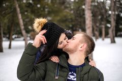 Happy couple have fun in winter park. royalty free stock photo