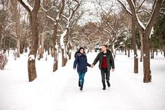 Happy couple have fun in winter park. royalty free stock image