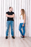 Happy couple have fun. Happy couple. Young men and women have fun near the wooden wall. Man in black t-shirt, girl in white Stock Photo