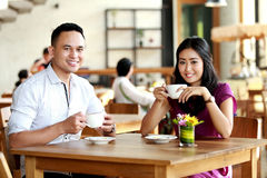 Happy couple have a good time at coffee shop Stock Photo