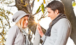 Happy couple have a romance in fall  leaves of the branches Stock Photo