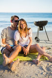 Happy couple having barbecue together Stock Image
