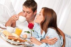 Happy couple having breakfast Royalty Free Stock Image