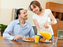 Happy couple having breakfast with croissants Royalty Free Stock Photos